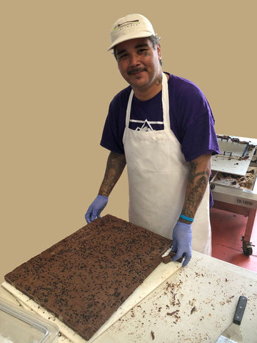 Boulder company baking brownies at Community Table Kitchen. As seen in Fast Company!