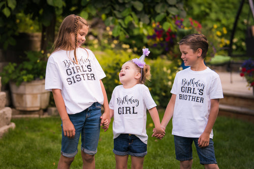 Birthday girl's sister, birthday girl, birthday girl's brother family wearing white t-shirts