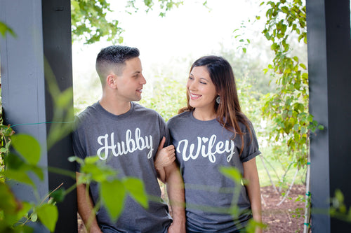 Man and Woman wearing Hubby and Wifey t-shirts in gray
