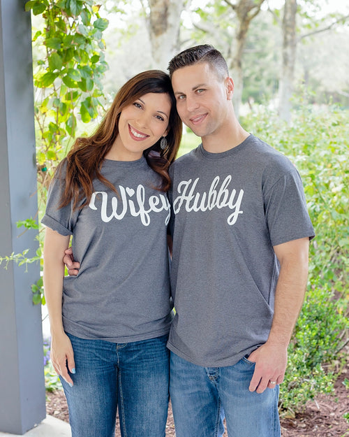 Man and woman embracing wearing Wifey and Hubby t-shirts in gray color