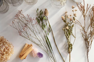 Embody Mood Board including Dried Flowers, Palo Santo, Rose Quartz, Amethyst, Mason Jars