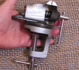 Bench vice, for Small work,  2 inch wide jaw, opens to 1 1/2 inch, swivel head, up to 1 1/2 inches - Romazone