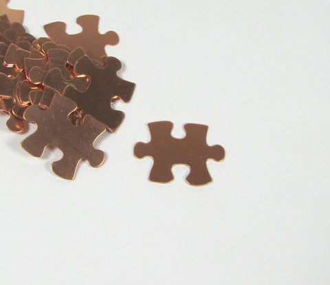 Copper Puzzle Blank,  puzzle piece, 22 gauge copper,  20mm x 16mm, 15 pack, autism stamp symbol,  for stamping, puzzle shape, for stamping, - Romazone