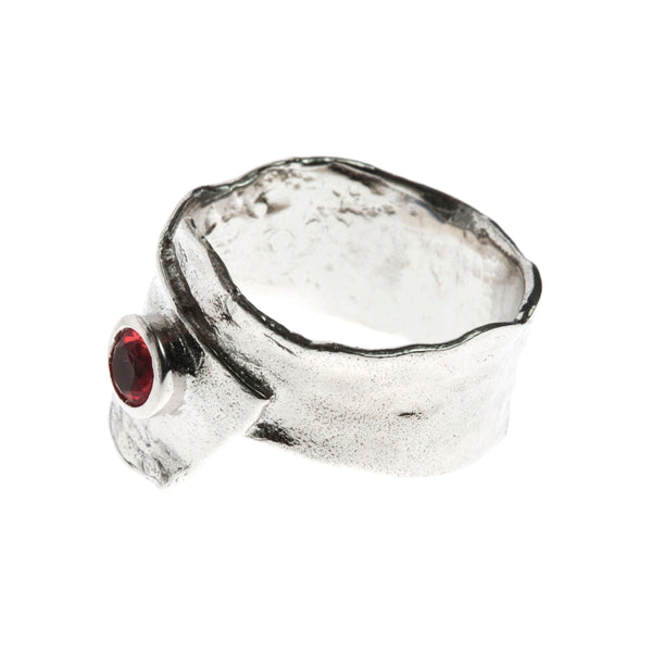 Metal silver ring with red cubic zirconia stone