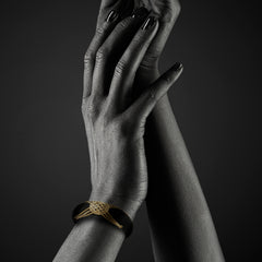 Woman wearing Polished Black wood Bangle with 22k gold wire