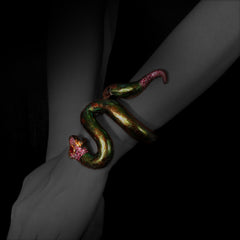 Woman wearing Snake Bangle with Scarab & Pink tourmaline
