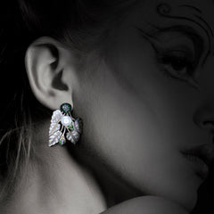 Woman wearing Carved Shell Earrings with Tsavorite, Diamonds & Pearl