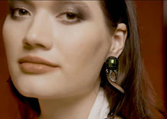 Woman wearing Crazy Wood Earrings with Scarab Bead and Tsavorite