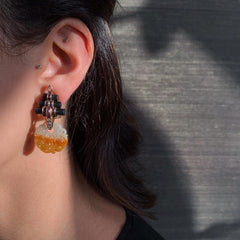 Woman wearing Carved Brown Jade Earrings with Pink Tourmaline