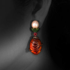 Woman wearing Amber Earrings with Scarab , Pearl & Pink Tourmaline