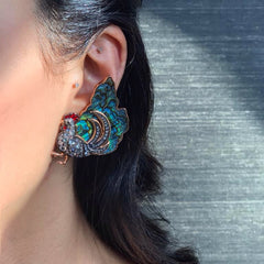 Woman wearing Chicken Earrings with Abalone Shell Diamond
