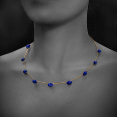 Woman wearing Taveez Necklace with Lapis