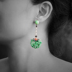Woman wearing Jade Earrings with Diamond, Carved Red Stone Flower