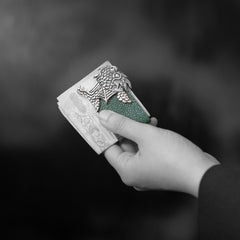 Man holding Galuchat Leather Money Clip with Dragon Fish