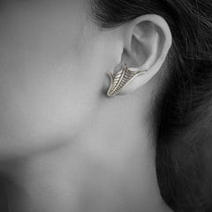 Woman wearing Dragon Fish Fin Earrings