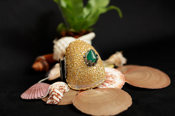 Carved Batulaga Shell Bangle with Zambian Emerald