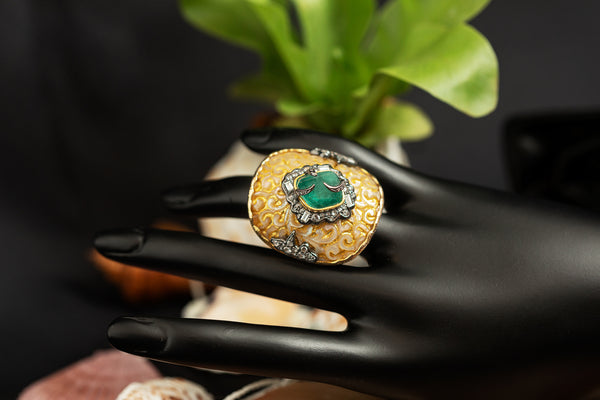 Carved Batulaga Shell Ring with Zambian Emerald