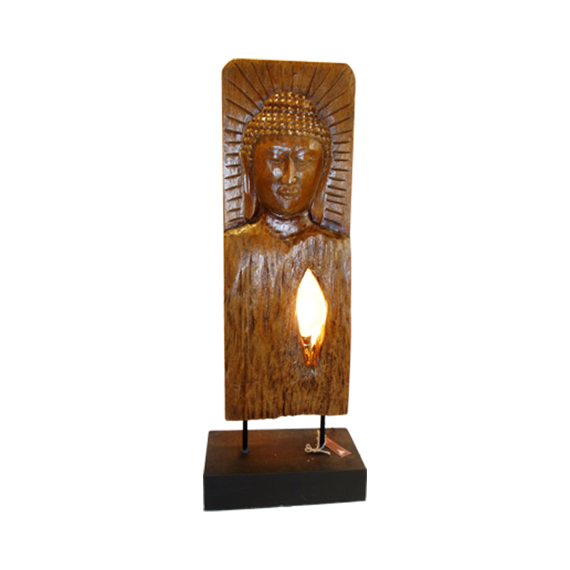 Our favourite Budda is backed up by the light behind,  who will not be drawn by peaceful look of Budda? made of old teak.