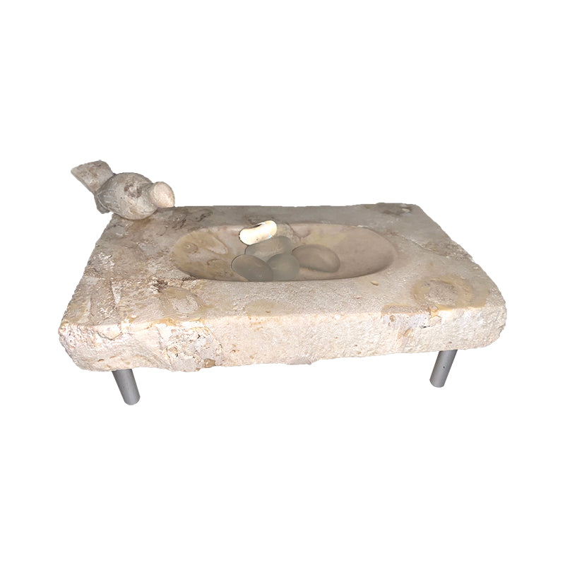 Bird on marble soap dish