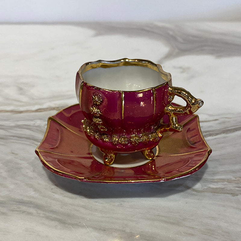 Three cups and sub-cups in red porcelain flashed w/gold