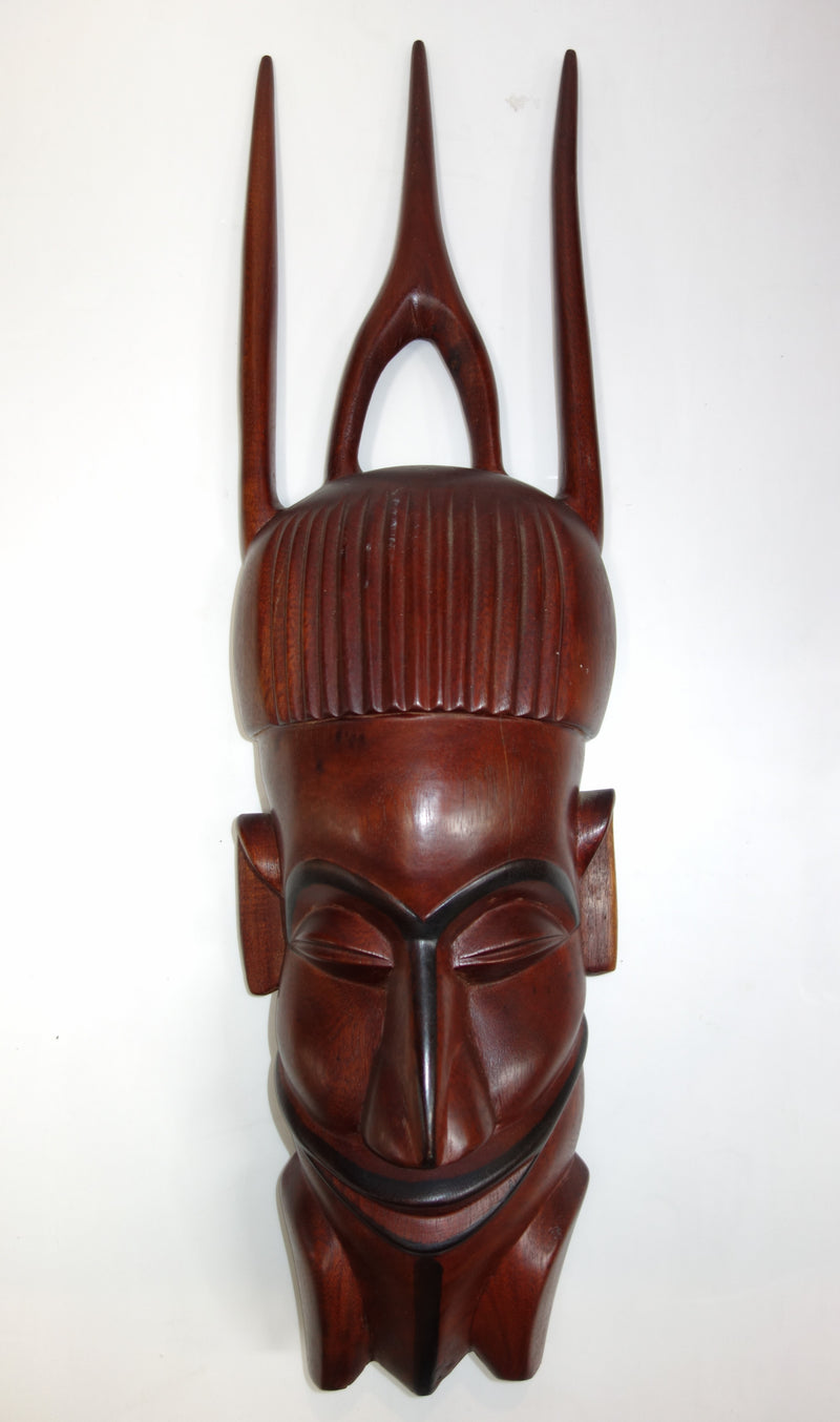 wooden tribal face sculpure