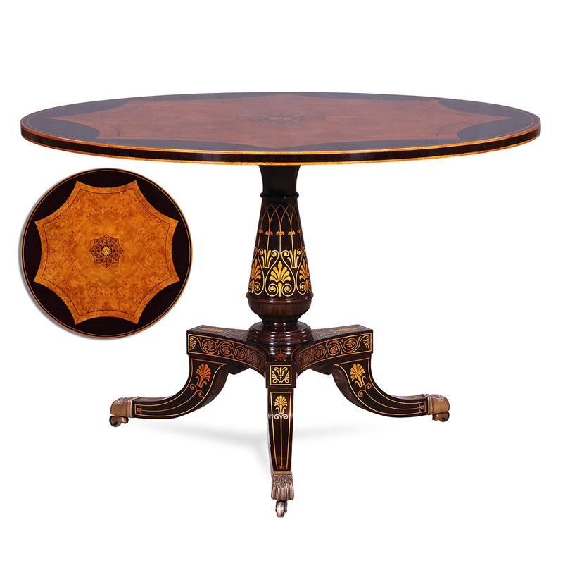 Superbly elegant Center Table. Mahogany base with brass lion paw casters. rich gold decoration on special finish with a beautiful burl veneered top and various inlays