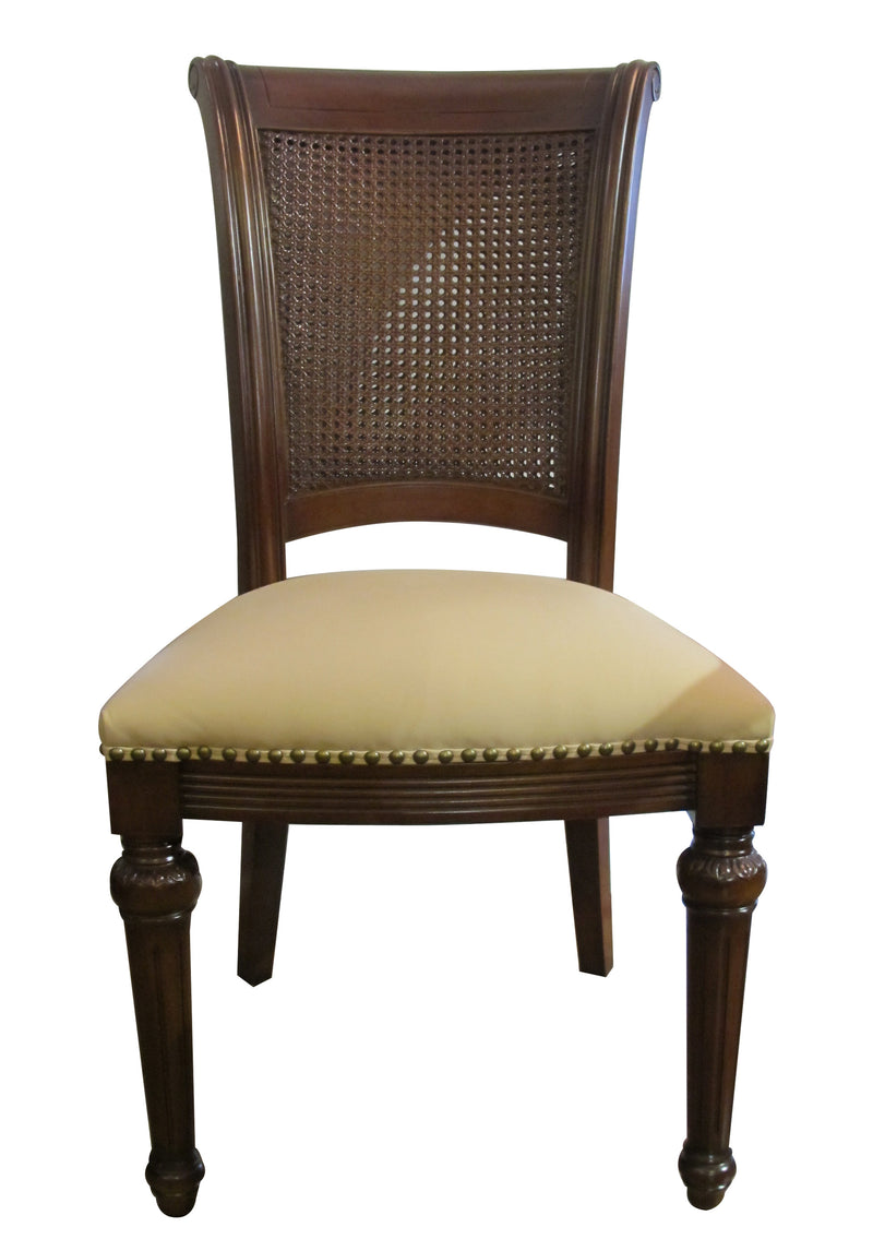 Rattan back on beige leather seat, Jaegar is a classical chair with a modern twist.