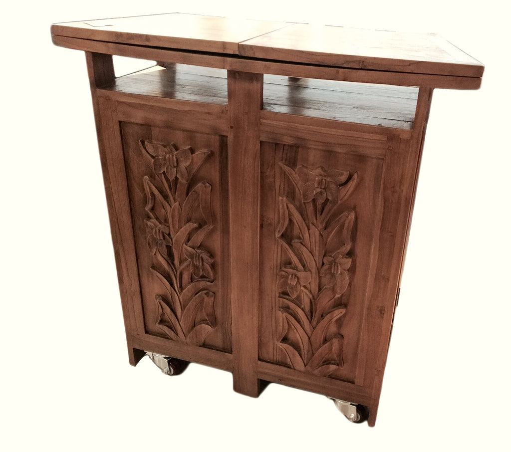 If you are looking for ultimate bar counter, our flower Bar Table is just the right choice for you. Solid teak, 6 panels hand carved in tasteful orchids, fully compartmented with wine bottle, glasses, drinks, and its on four wheels!  a perfect piece to entertain guests at home.
