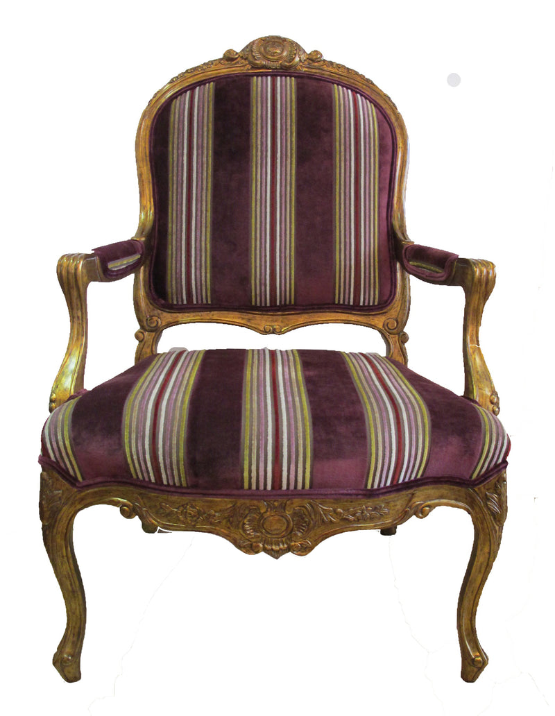 Louis XV Fauteuil  made of  hand carved mahogany with gold painted accents, it's graceful silhouette epitomizes the classic beauty of French furniture.