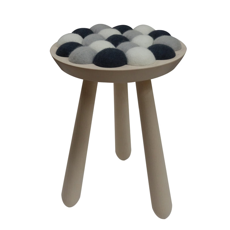 "The ""cool with wool"" stool is inspired by the lambs on the fields, which  made this colorful stool come alive. Designed by Aud Julie Befring of Sweden Brand-Aveva. This stool is  hand made of 100% spung wool and beech wood. they are a dozen  combination of colors if customer has a special request."