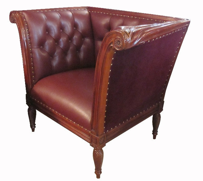 This lovely club chair is made from solid mahogany and leather,  intricate carving by seasoned artisan created a captivating silhouette. Seating is not too deep with gentle embracing back all around.