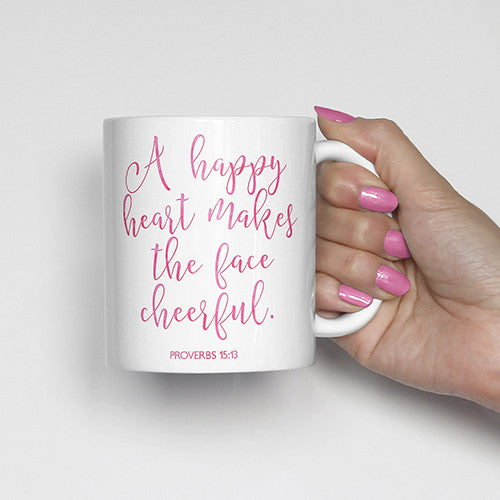 A happy heart makes the face cheerful. Proverbs 15:13, bible scripture, watercolor, calligraphy mug