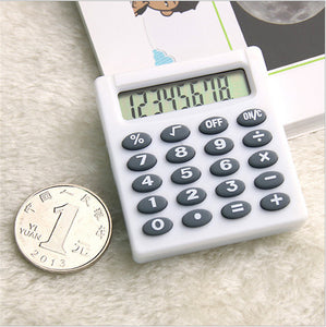 POCKET LCD MINI CALCULATOR CUTE COLORFUL HANDHELD COIN TYPE BATTERIES.