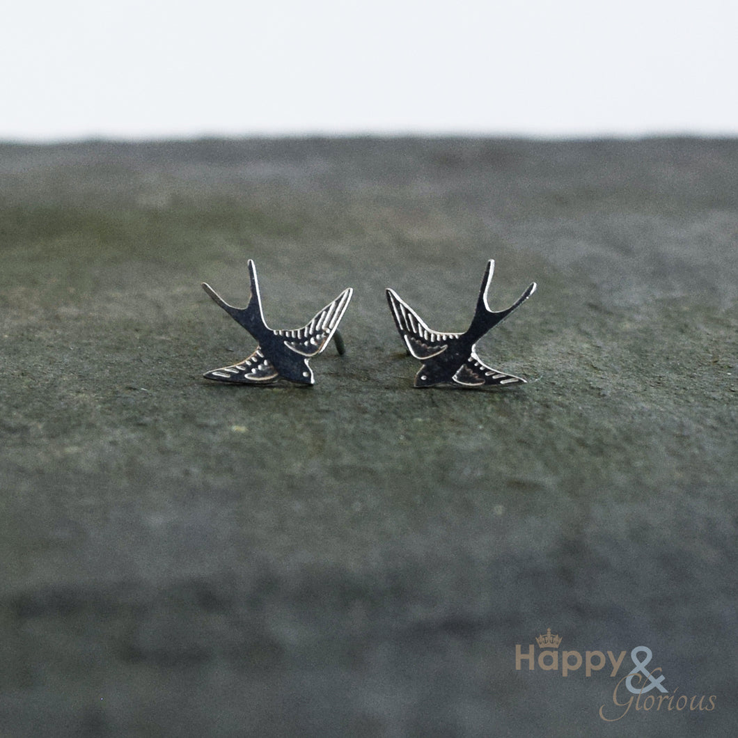 Sterling silver flying swallow stud earrings by Amanda Coleman