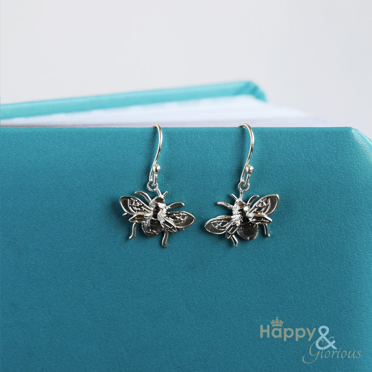 Sterling silver bumblebee drop earrings by Amanda Coleman