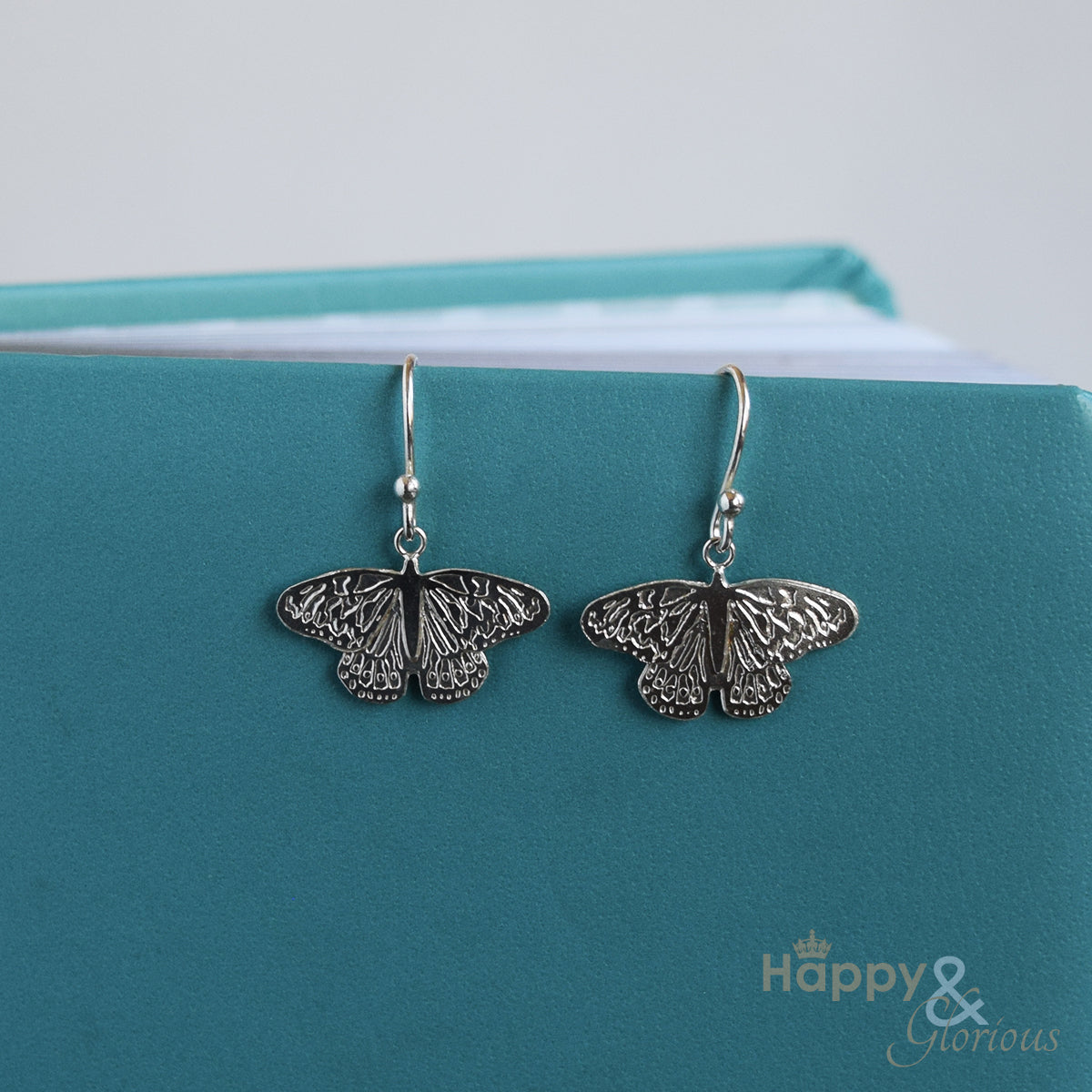 Sterling silver butterfly drop earrings by Amanda Coleman