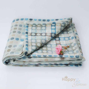Aqua blue 'Mondo' spot pure lambswool throw by Melin Tregwynt
