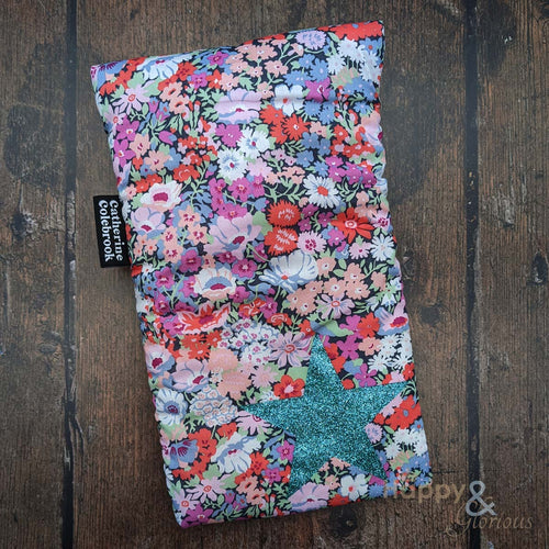 Liberty fabric mini hot water bottle with aqua blue glitter star