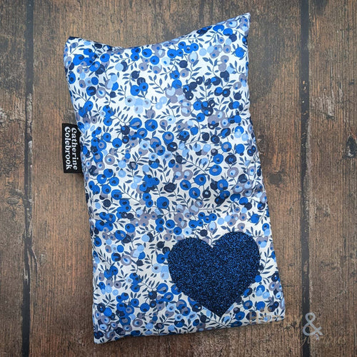 Liberty fabric mini hot water bottle with indigo blue glitter heart
