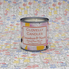 Clovelly essential oil candle in tin