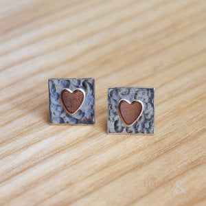 Sterling silver stud earrings with brass heart detail