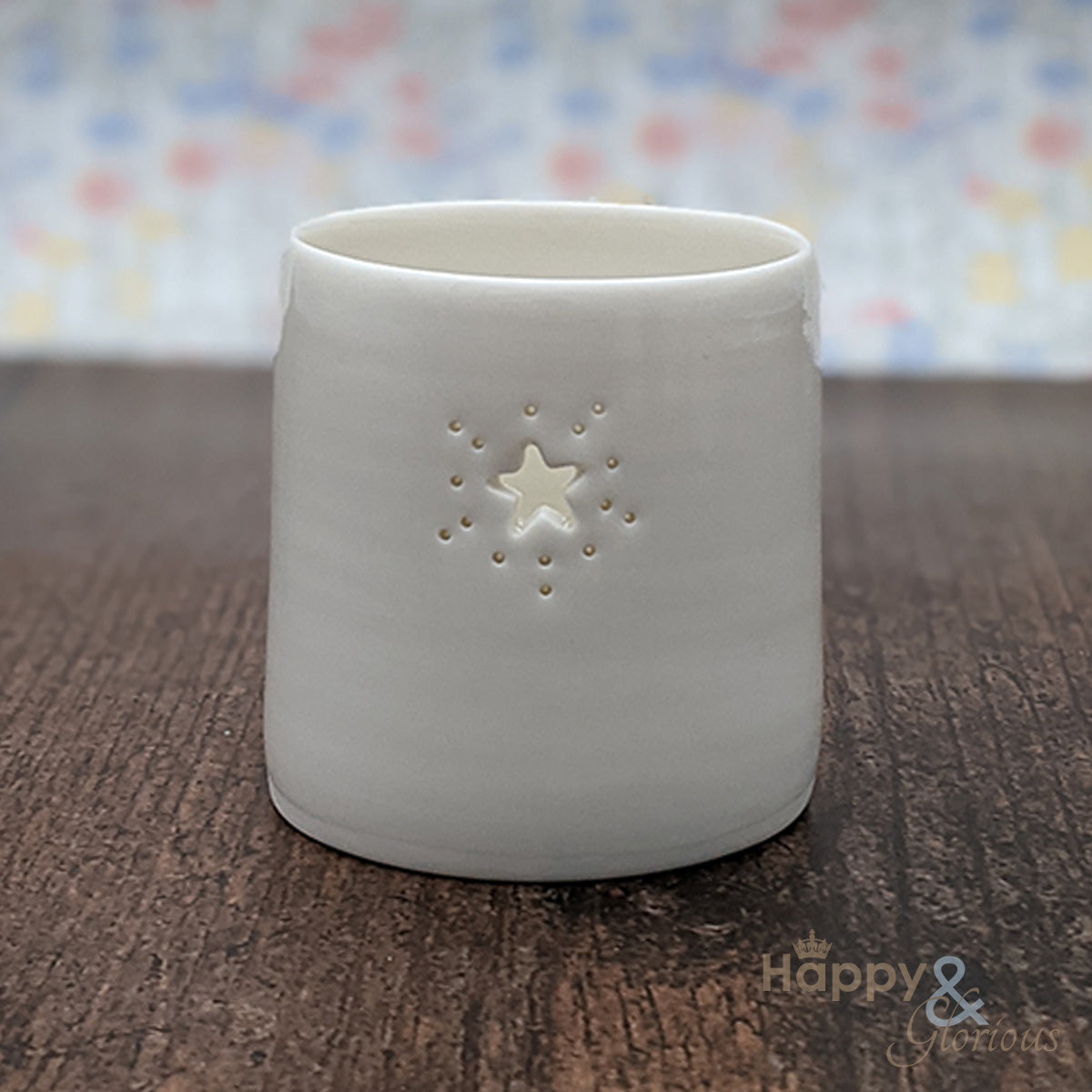 Porcelain starburst tealight candle holder by Luna Lighting