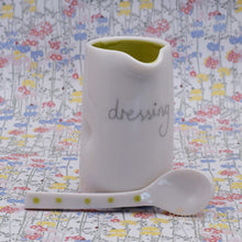 Porcelain dressing jug and spoon by Penny Spooner