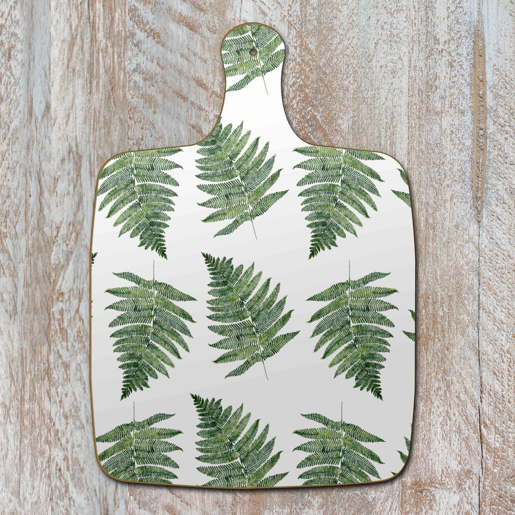 Ferns on white chopping board