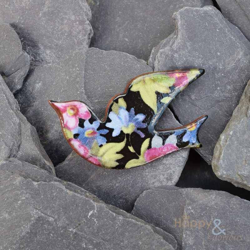 Black, pink and blue floral ceramic bird brooch by Stockwell Ceramics