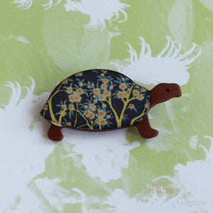 Blue floral ceramic tortoise brooch by Stockwell Ceramics