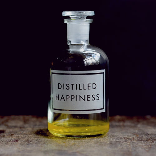 'Distilled Happiness' etched glass apothecary bottle