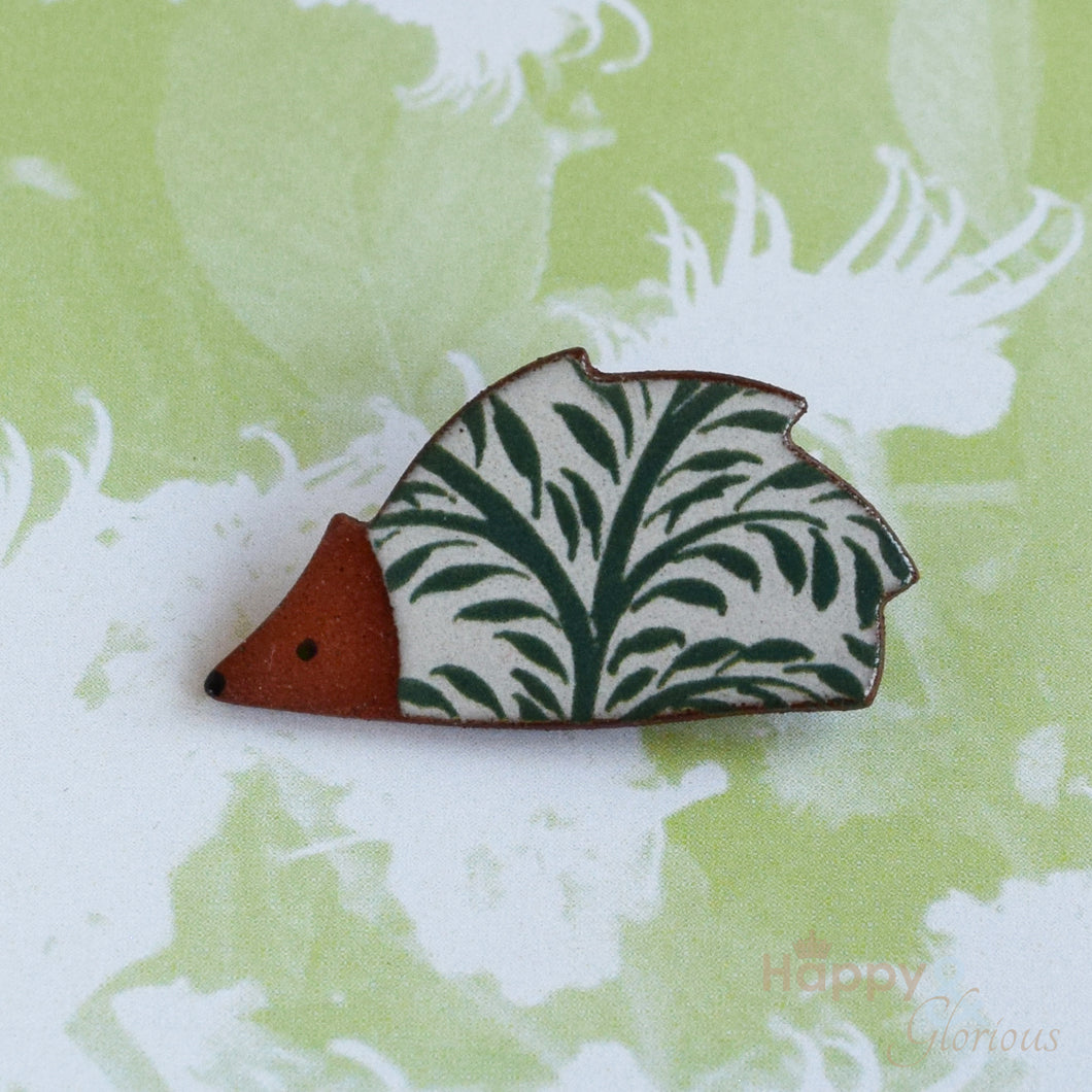 Green leaf ceramic hedgehog brooch by Stockwell Ceramics