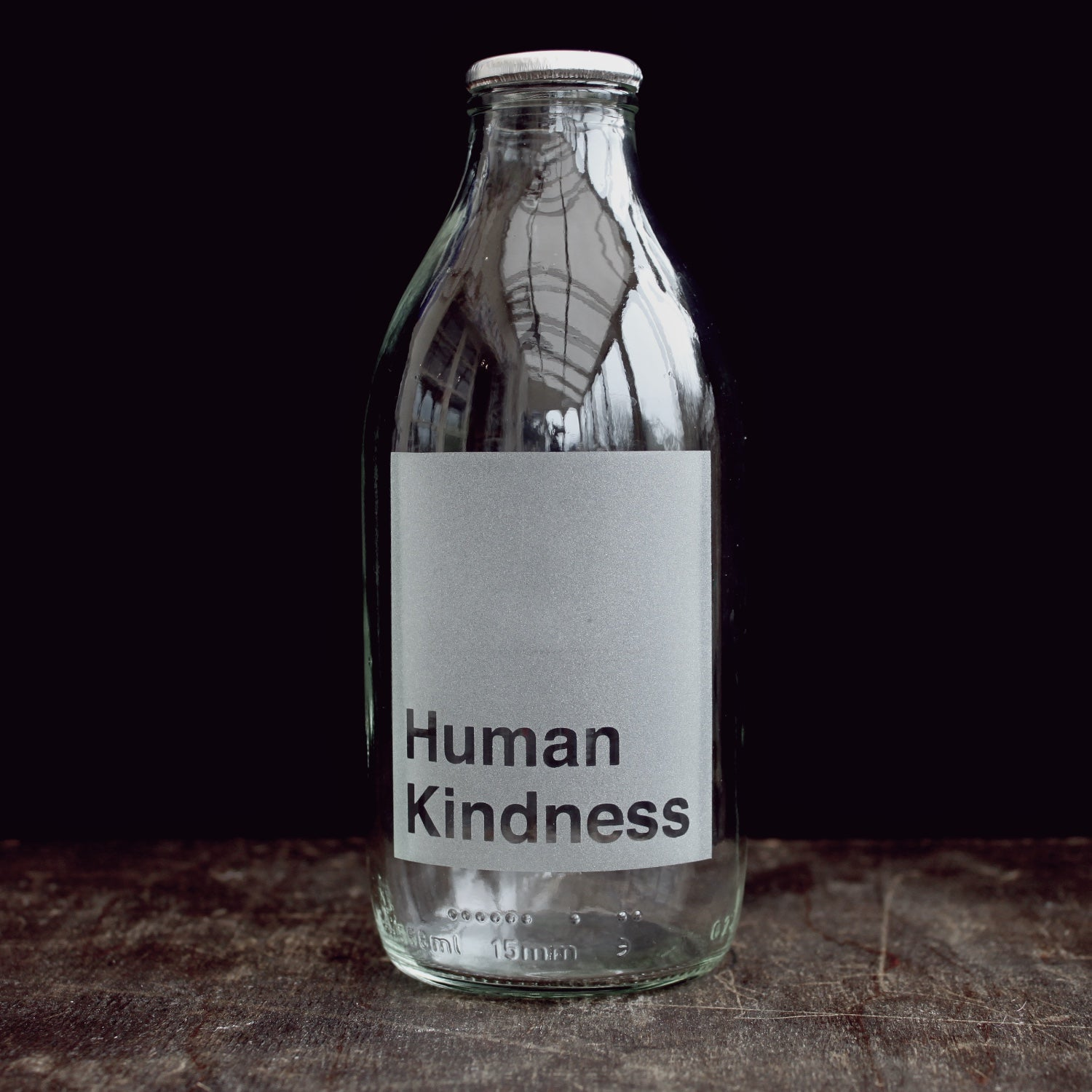 'Human Kindness' etched glass milk bottle