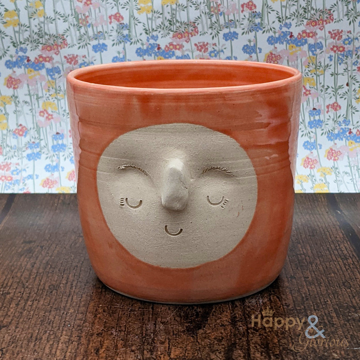 Hand thrown poppy pink stoneware face plant pot